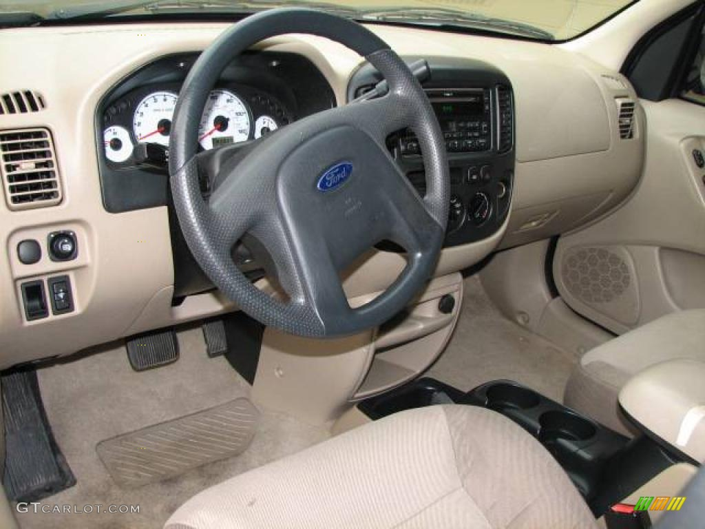 2003 true blue metallic ford escape xls v6 4wd 3097469. Black Bedroom Furniture Sets. Home Design Ideas