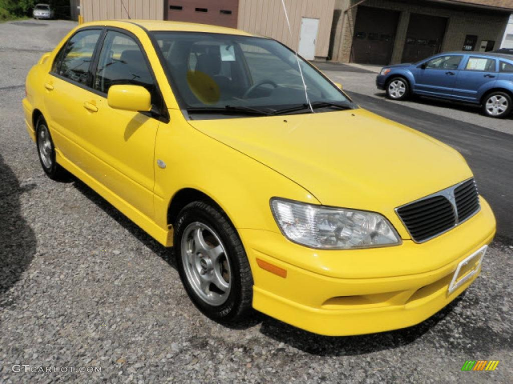 2002 lightning yellow mitsubishi lancer oz rally 31426612. Black Bedroom Furniture Sets. Home Design Ideas