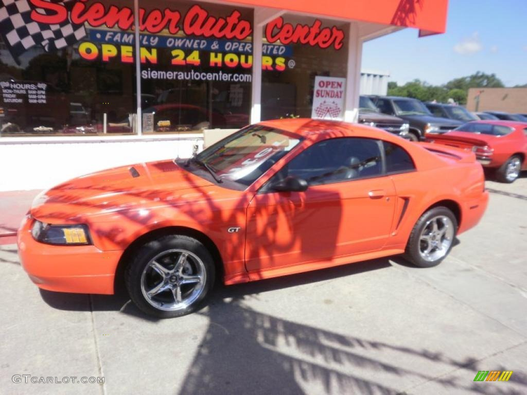 2000 Mustang GT Coupe - Performance Red / Dark Charcoal photo #2