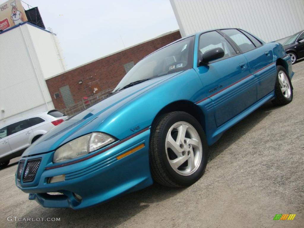 Brilliant blue metallic pontiac grand am