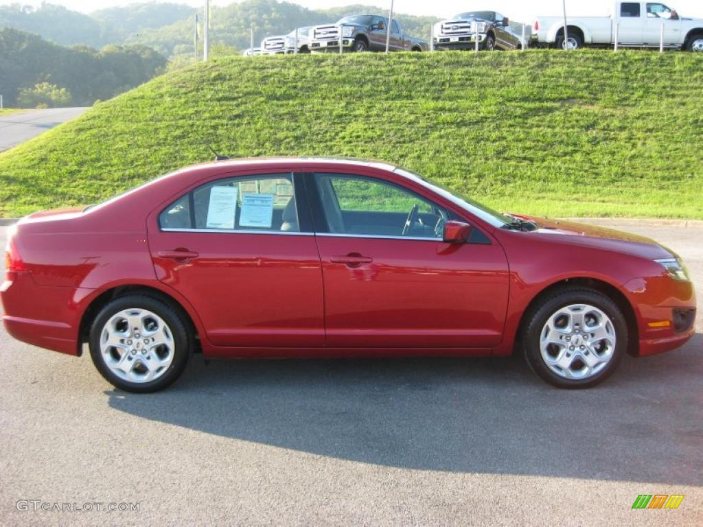 2011 Fusion SE V6 - Red Candy Metallic / Medium Light Stone photo #5