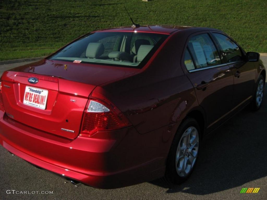 2011 Fusion SE V6 - Red Candy Metallic / Medium Light Stone photo #6