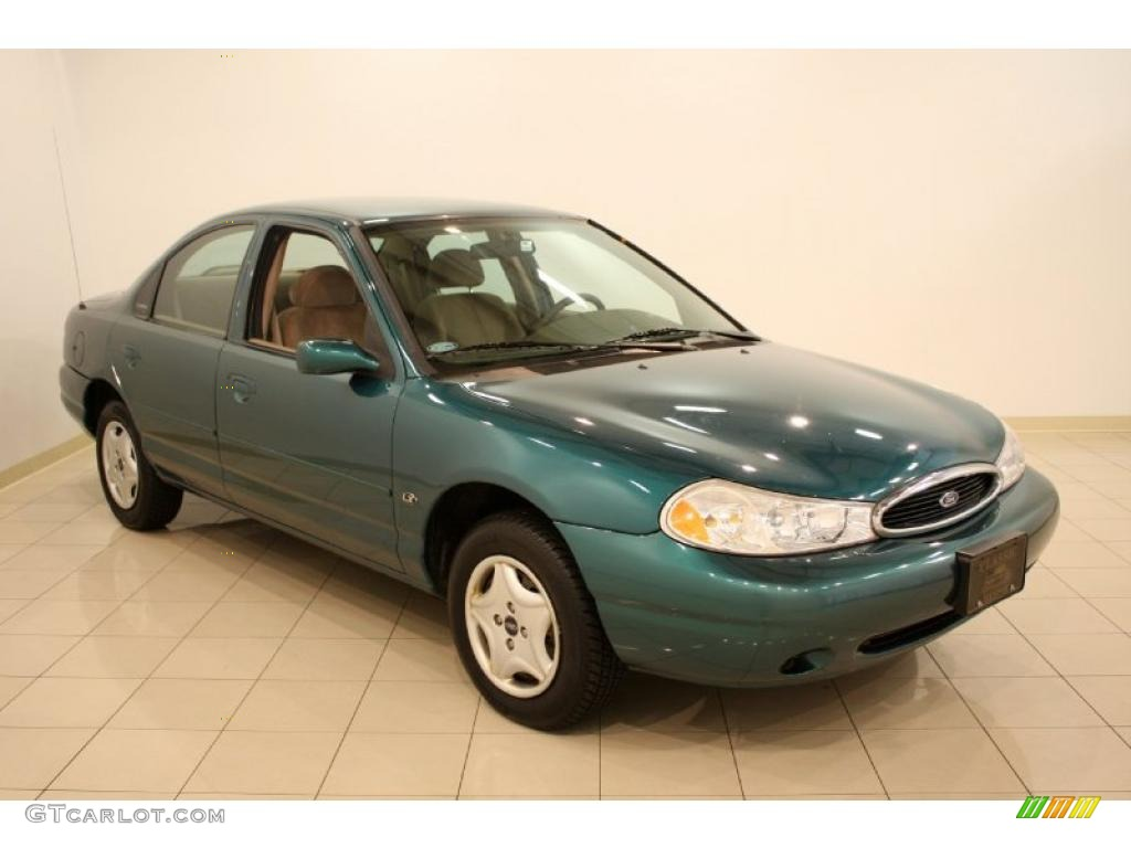 Pacific green metallic ford contour