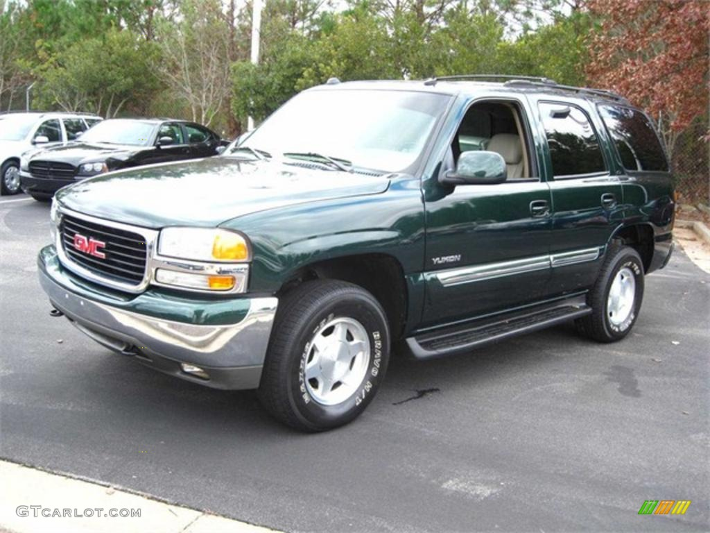 Polo green metallic gmc yukon