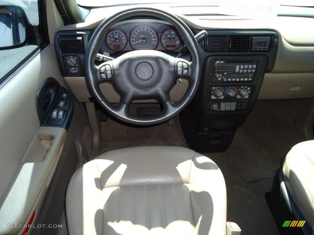 2004 Pontiac Montana Standard Montana Model Taupe Dashboard Photo  38359730
