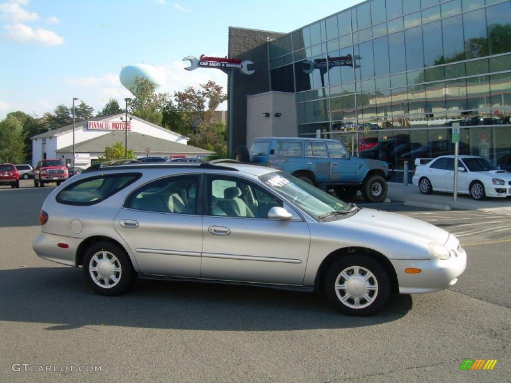 1998 silver frost metallic ford taurus se wagon 38474571. Black Bedroom Furniture Sets. Home Design Ideas