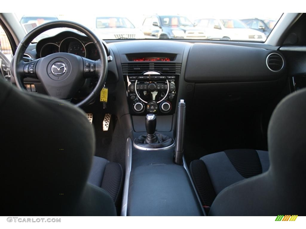 2005 mazda rx 8 standard rx 8 model black dashboard photo. Black Bedroom Furniture Sets. Home Design Ideas