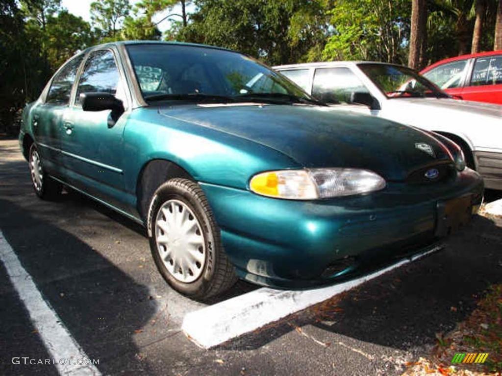 Pacific green metallic ford contour