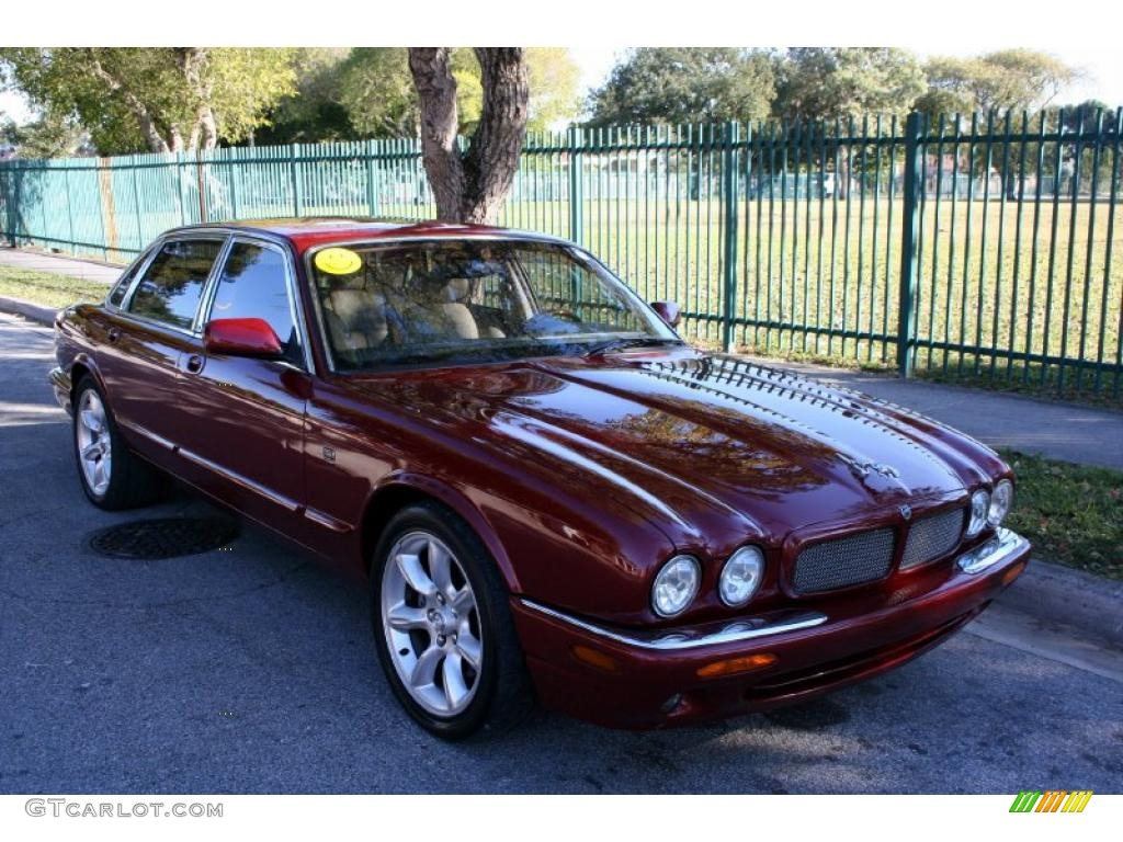Carnival red metallic 2001 jaguar xj xjr exterior photo 41476535