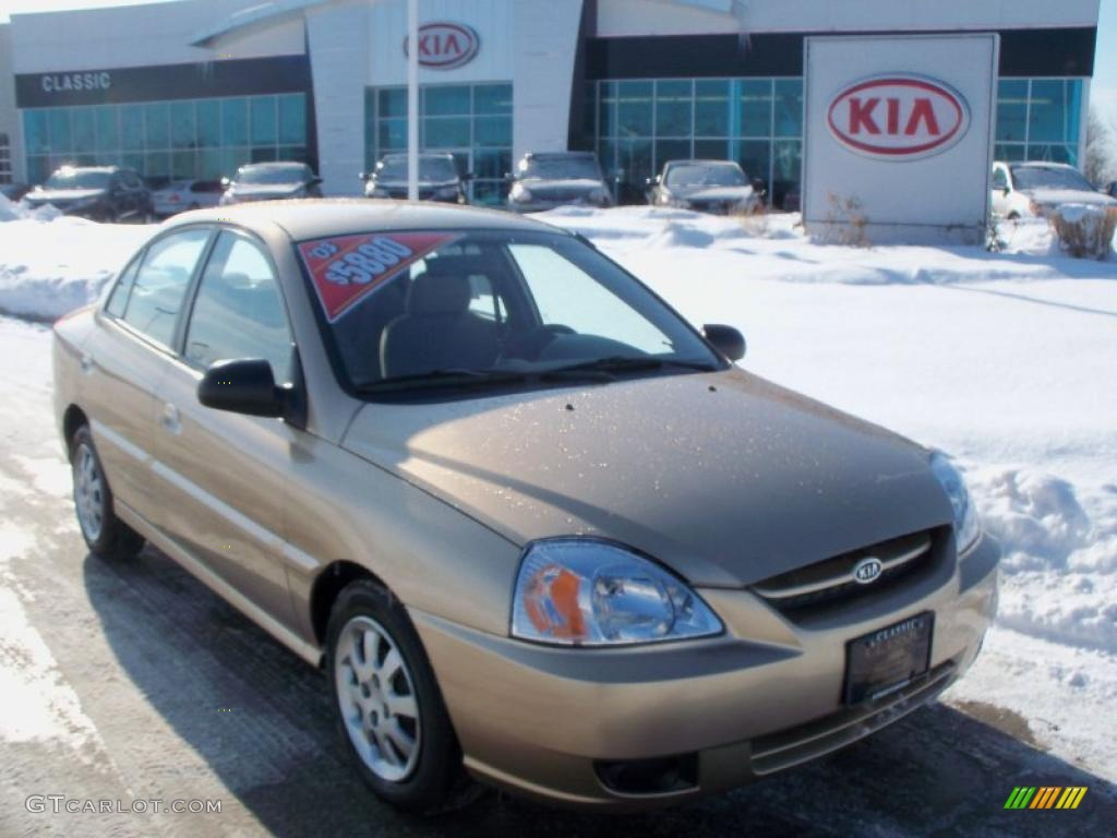 2003 light gold kia rio sedan 41701125. Black Bedroom Furniture Sets. Home Design Ideas