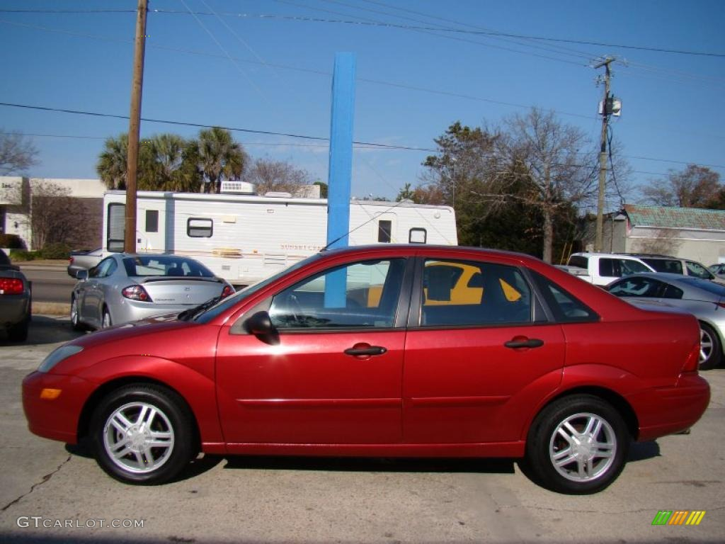 sangria red metallic 2003 ford focus se sedan exterior photo 42255725. Black Bedroom Furniture Sets. Home Design Ideas