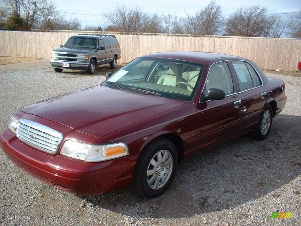Dark toreador red metallic 2006 ford crown victoria lx for Crown motors ford redding