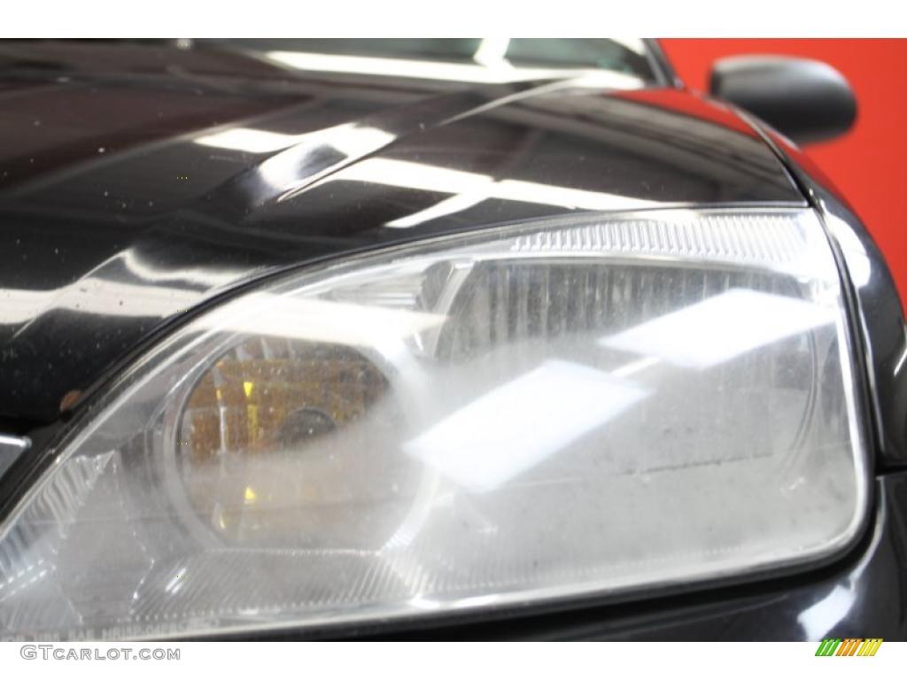 2005 Focus ZX4 S Sedan - Pitch Black / Dark Flint/Light Flint photo #18