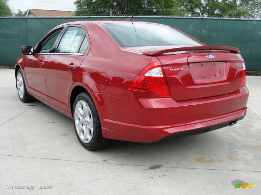 2011 Fusion SE - Red Candy Metallic / Charcoal Black photo #5