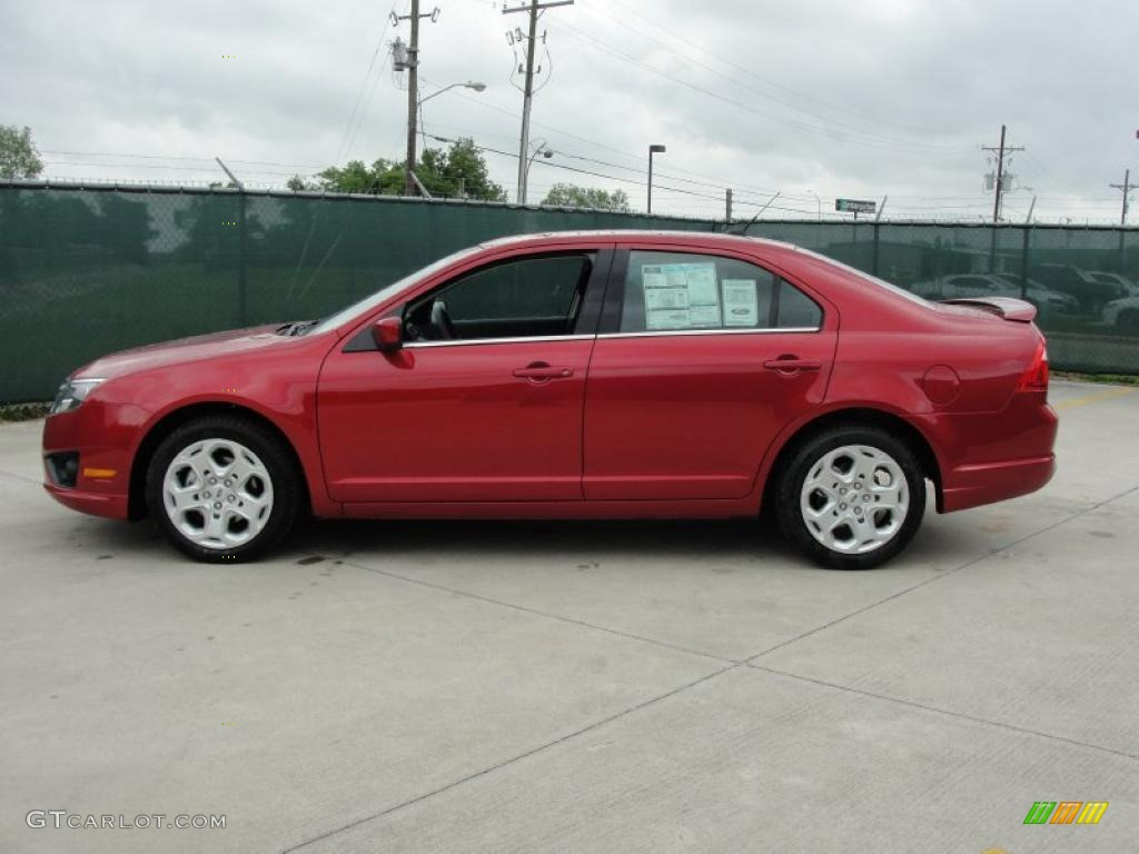 2011 Fusion SE - Red Candy Metallic / Charcoal Black photo #6
