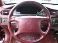 1999 Cadillac DeVille Mulberry Interior Steering Wheel Photo
