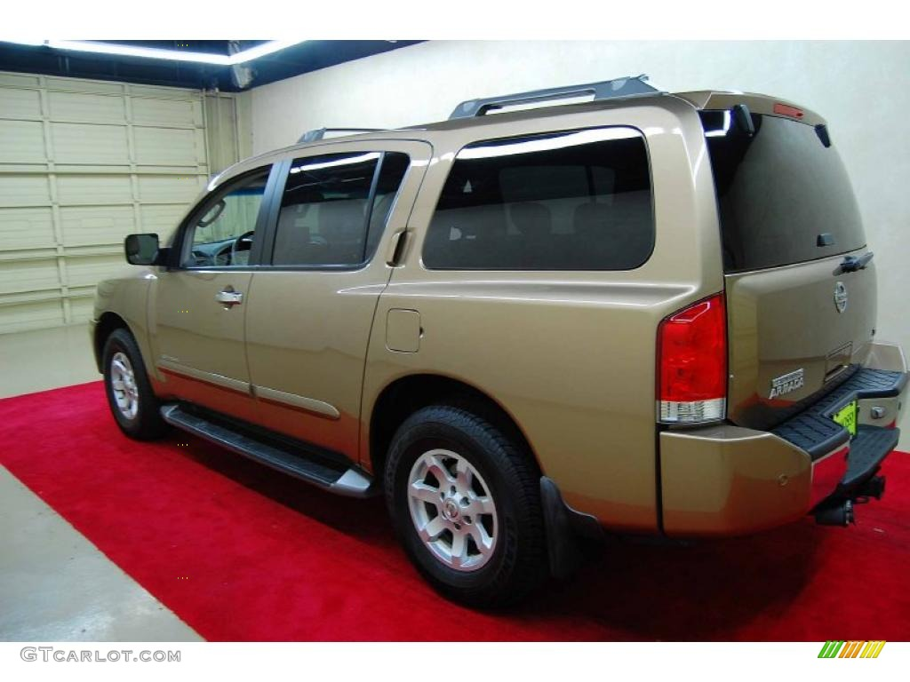 Nissan moruya part 131 gold metallic 2004 nissan armada se 4x4 exterior photo 49210916 49210915 vanachro Choice Image
