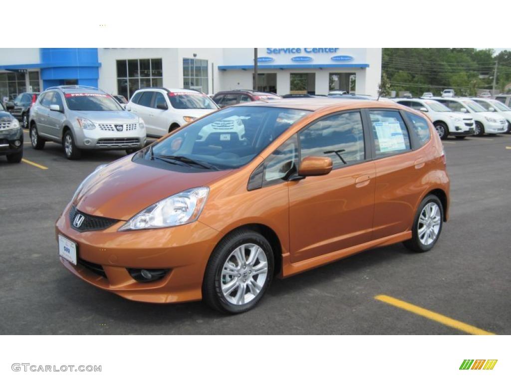 2011 orange revolution metallic honda fit sport 49418430 for Orange honda fit