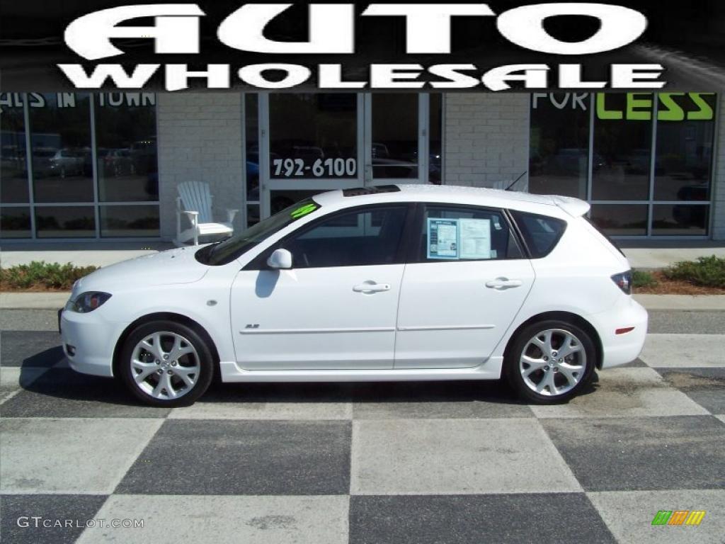 White Mazda 3 2009