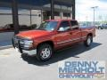 2001 Sunset Orange Metallic Chevrolet Silverado 1500 LS Extended Cab 4x4 #49799505