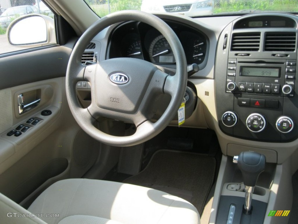2007 kia spectra ex sedan beige dashboard photo 50306472. Black Bedroom Furniture Sets. Home Design Ideas