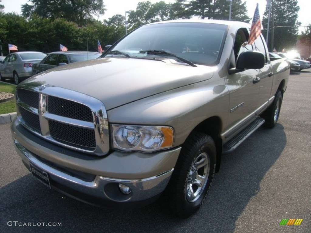 2002 Ram 1500 SLT Quad Cab 4x4 - Light Almond Pearl / Taupe photo #1