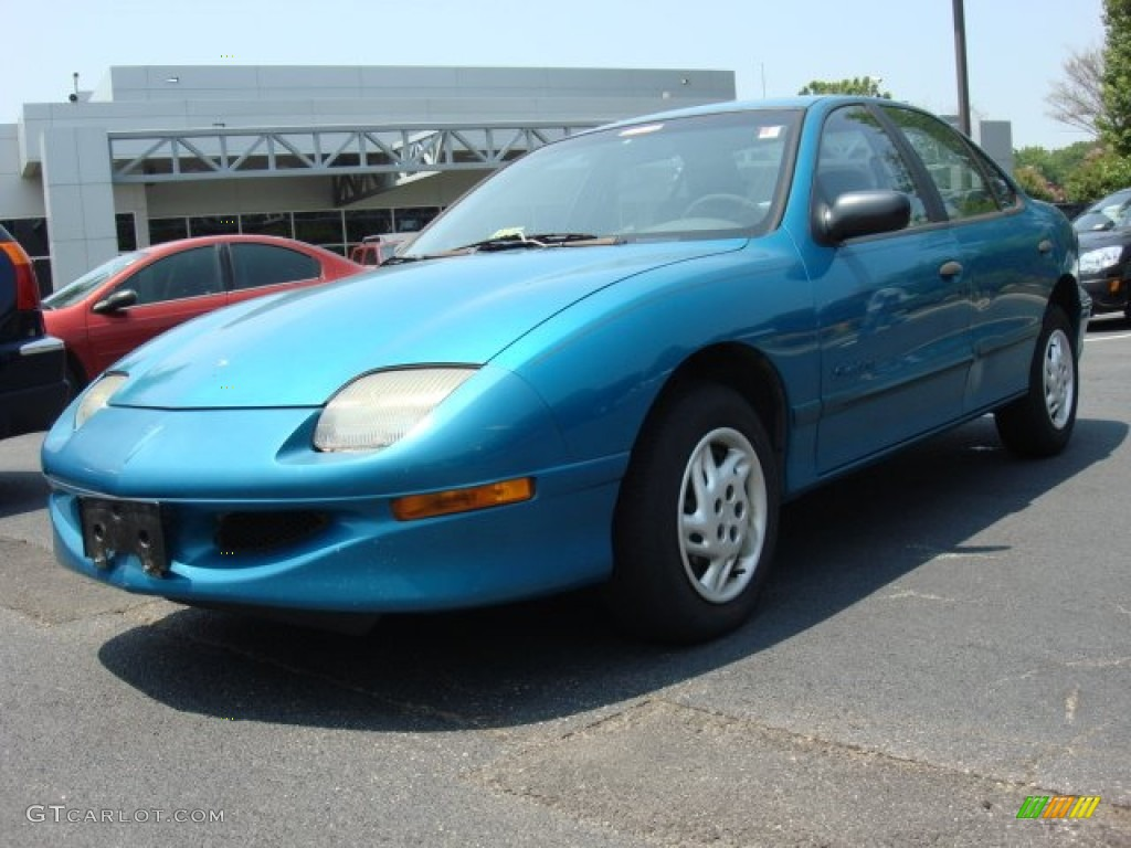 1997 bright blue metallic pontiac sunfire se sedan 50329491 gtcarlot com car color galleries gtcarlot com