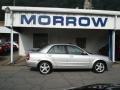 Sunlight Silver Metallic 2002 Mazda Protege ES