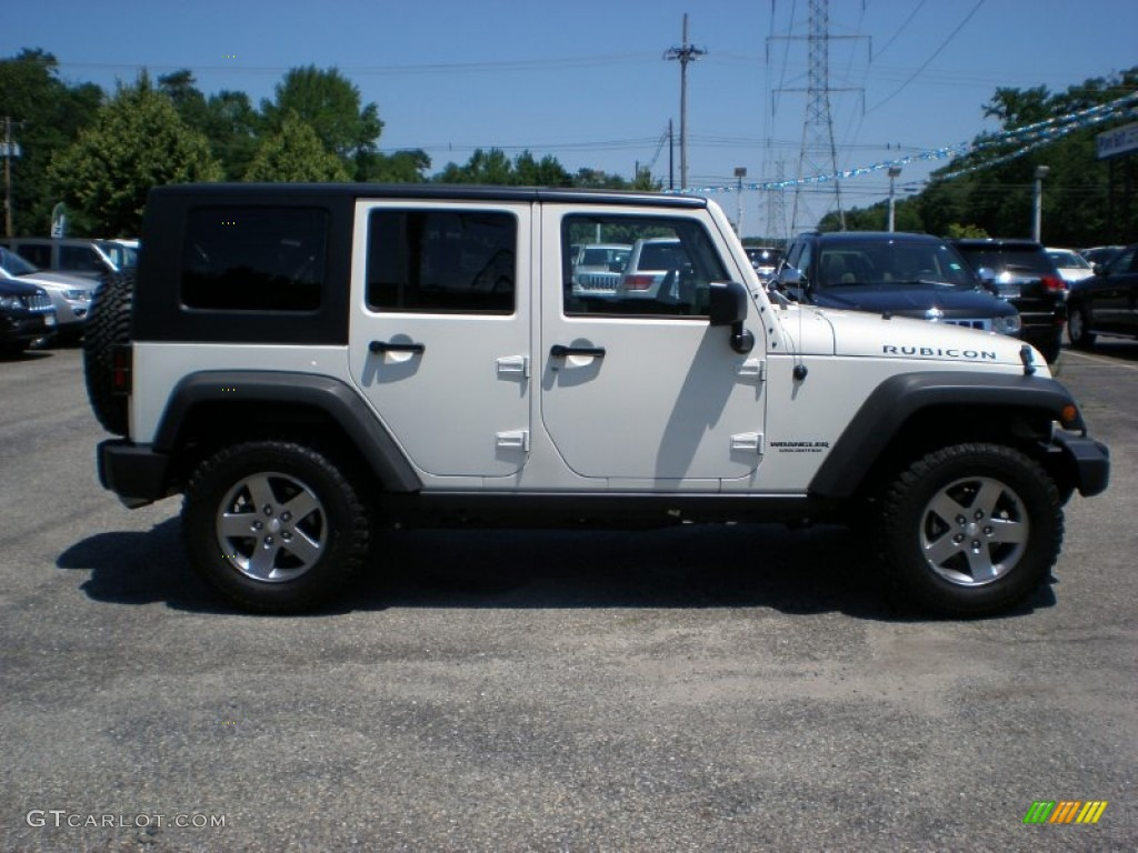 stone white 2010 jeep wrangler unlimited rubicon 4x4 exterior photo. Cars Review. Best American Auto & Cars Review