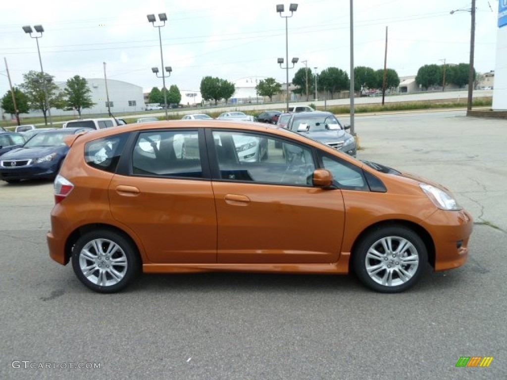 Orange revolution metallic 2011 honda fit sport exterior for Orange honda fit