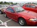 2000 Laser Red Metallic Ford Mustang V6 Coupe  photo #1