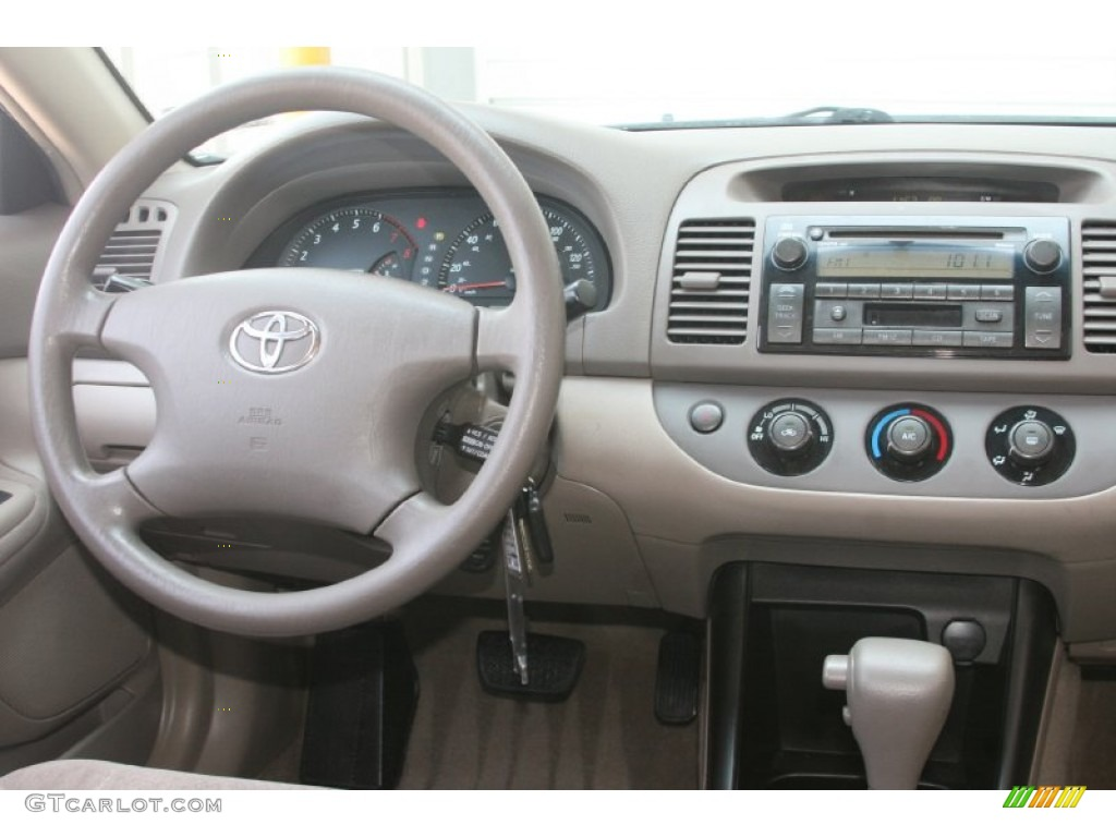 2003 toyota camry le taupe dashboard photo 52449682. Black Bedroom Furniture Sets. Home Design Ideas