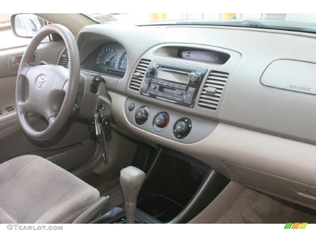 2003 toyota camry le taupe dashboard photo 52449754. Black Bedroom Furniture Sets. Home Design Ideas