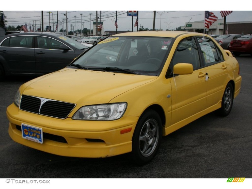lightning yellow 2002 mitsubishi lancer oz rally exterior. Black Bedroom Furniture Sets. Home Design Ideas