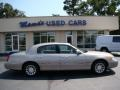 Light Parchment Gold Metallic 2000 Lincoln Town Car Signature