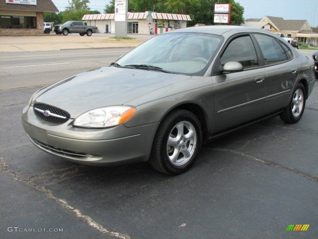 Spruce green metallic ford taurus
