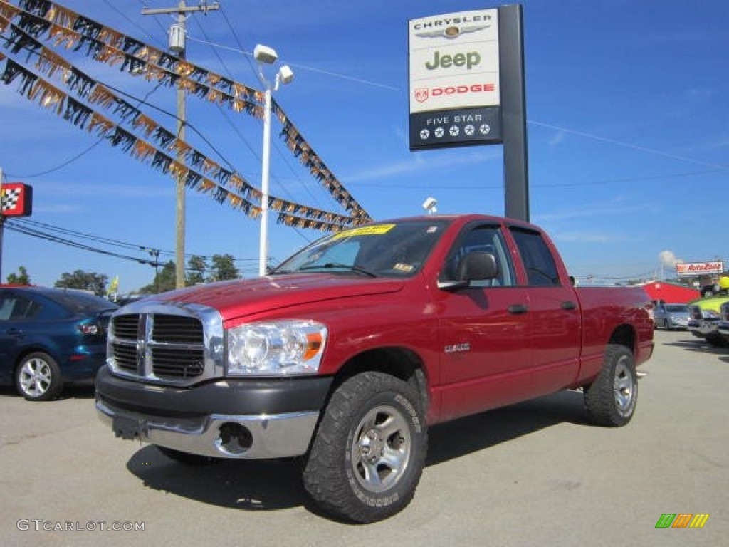 2008 Ram 1500 SXT Quad Cab 4x4 - Blaze Red Crystal Pearl / Medium Slate Gray photo #1