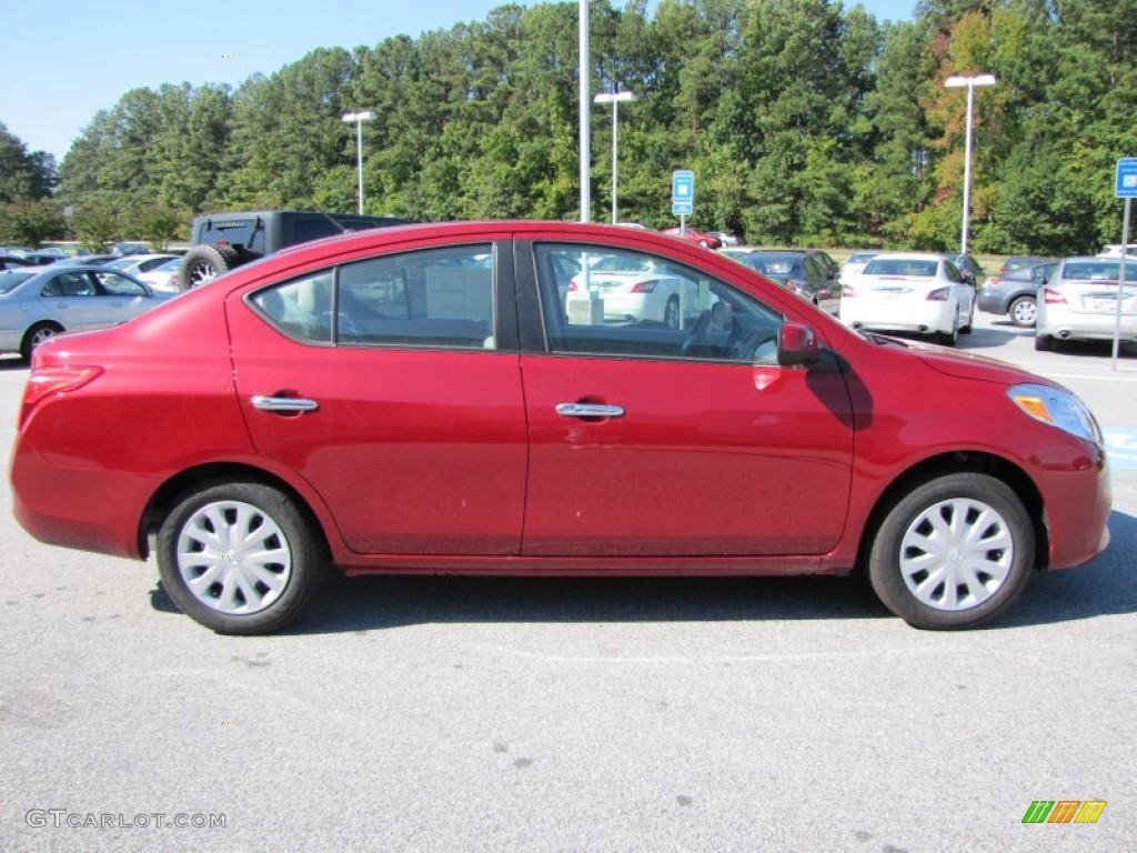 Red Brick 2012 Nissan Versa 1 6 Sv Sedan Exterior Photo