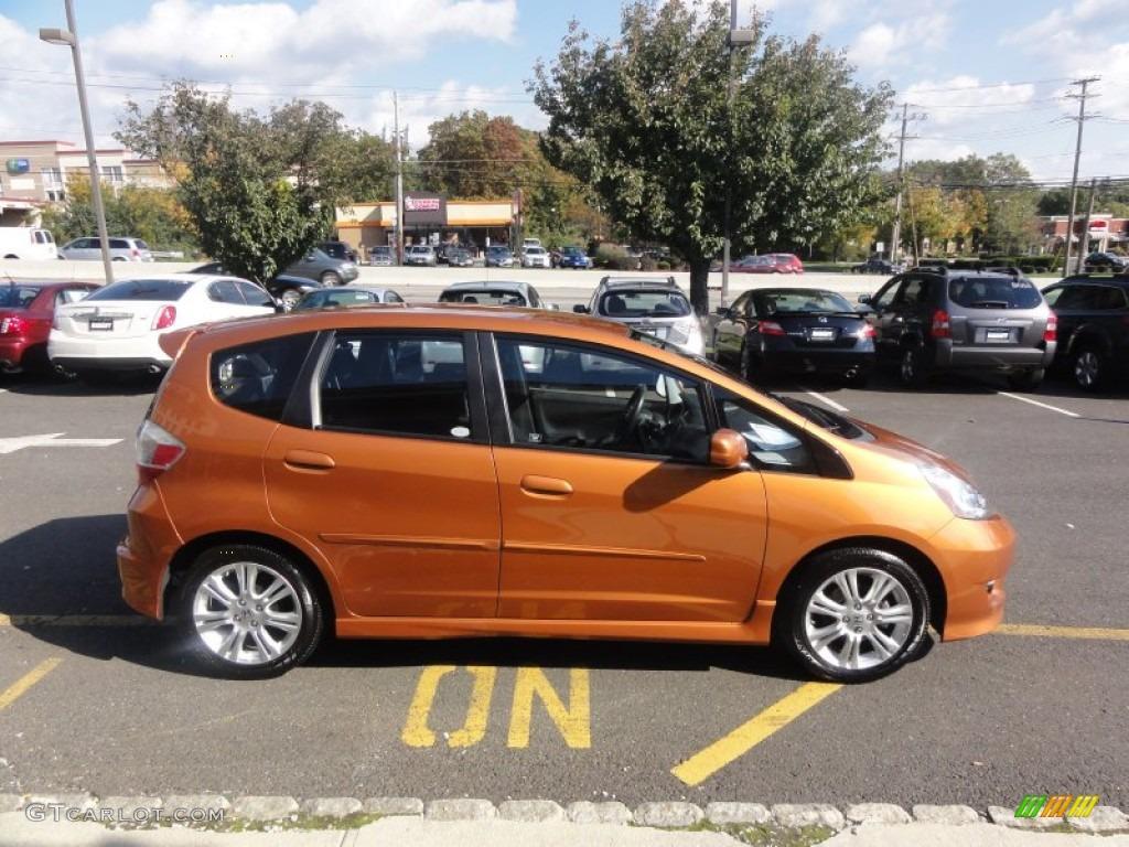 Orange revolution metallic 2009 honda fit sport exterior for Orange honda fit