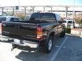 2002 Onyx Black Chevrolet Silverado 1500 LS Extended Cab 4x4  photo #2