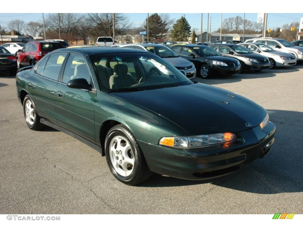 Forest green oldsmobile intrigue