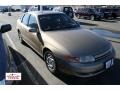 Medium Gold 2000 Saturn L Series LS1 Sedan