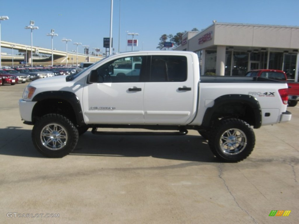 2011 blizzard white nissan titan pro 4x crew cab 4x4 59739317 photo 2 car. Black Bedroom Furniture Sets. Home Design Ideas