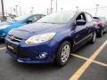 2012 Sonic Blue Metallic Ford Focus SE Sedan  photo #1