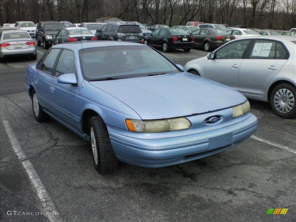 Crystal blue frost metallic ford taurus