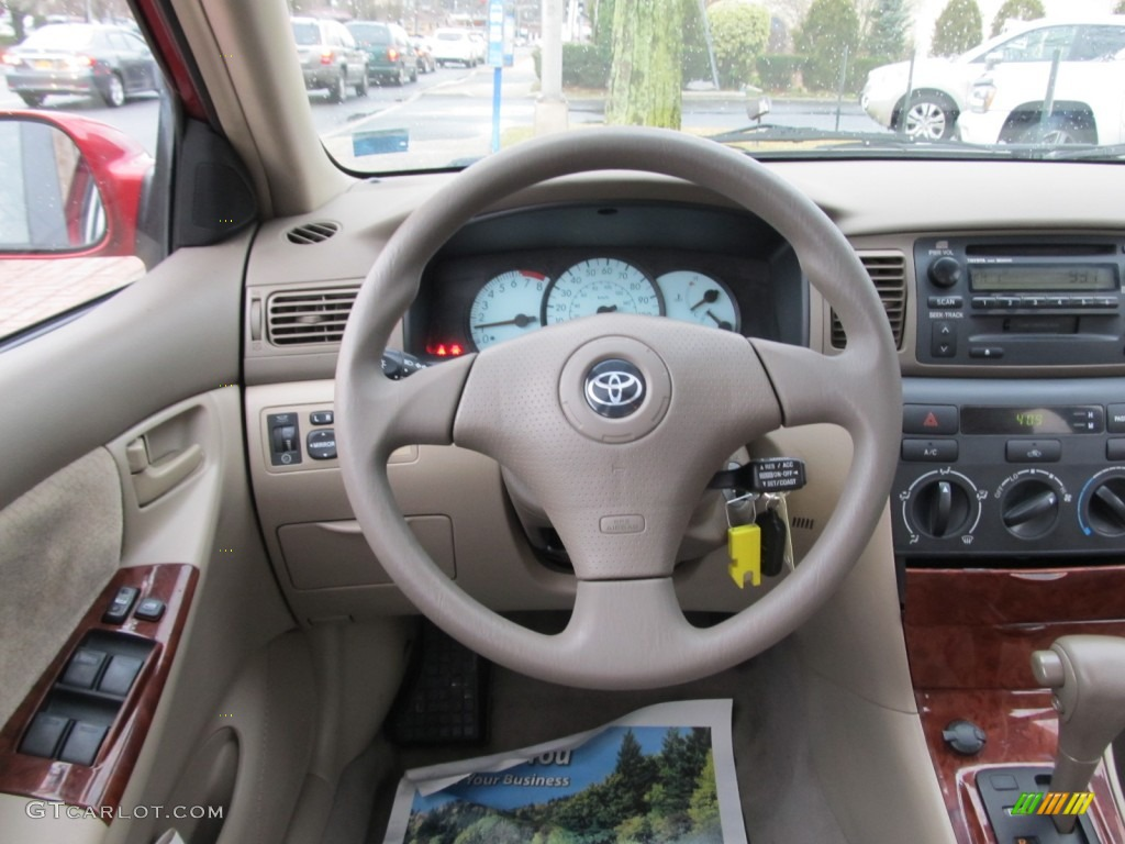 2003 toyota corolla le steering wheel photos for Toyota corolla 2003 interior