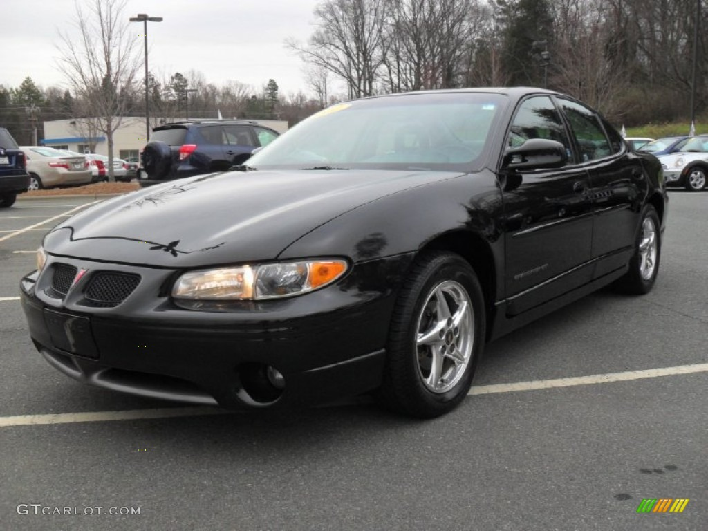 2002 black pontiac grand prix gt sedan 62757855. Black Bedroom Furniture Sets. Home Design Ideas