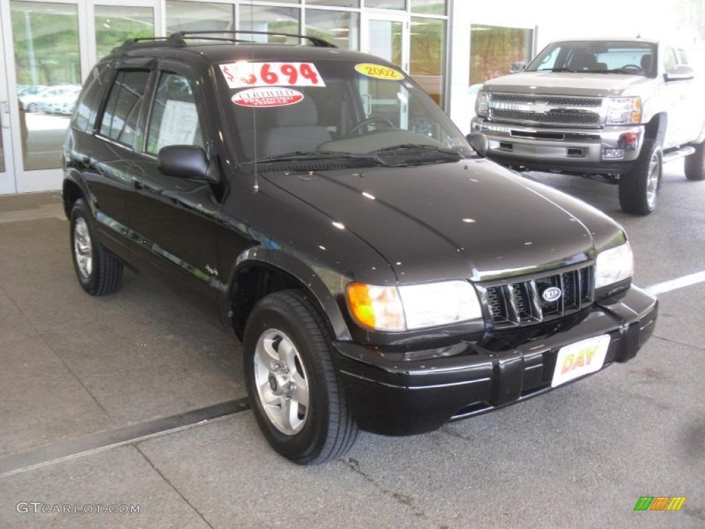 2002 black kia sportage 4x4 64663182 car. Black Bedroom Furniture Sets. Home Design Ideas