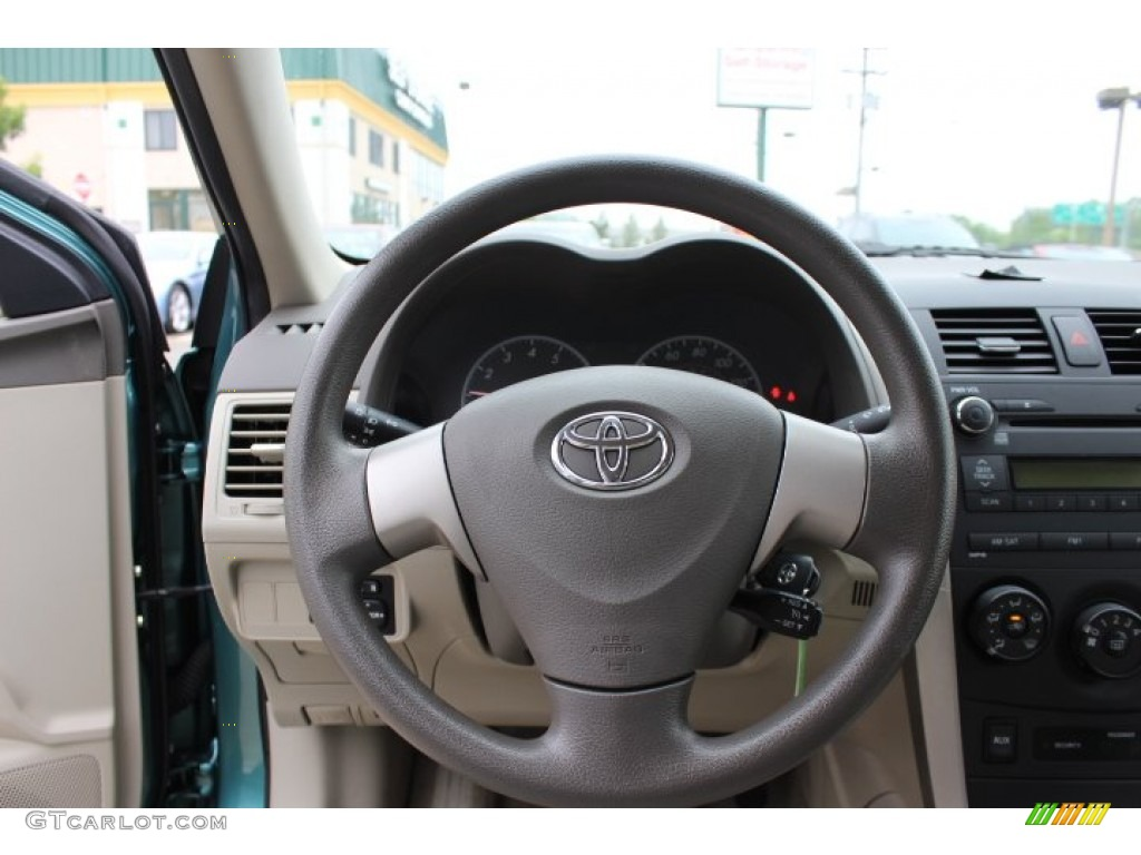 2010 toyota corolla le bisque steering wheel photo. Black Bedroom Furniture Sets. Home Design Ideas