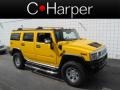 Yellow 2006 Hummer H2 SUV
